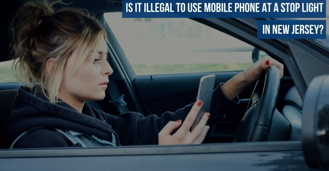 Is it Illegal to use a mobile phone at a Stop Light in New Jersey?